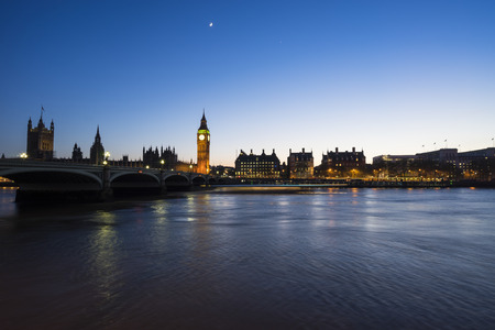 streaking: Westminster, the British parliament, and Westminster bridge captured from the South Bank, and a ferry is streaking across the water.