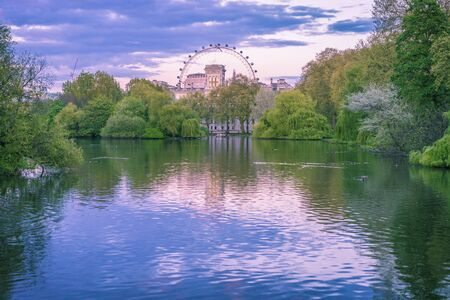 The lake in St James park London with the big wheel in the background photo