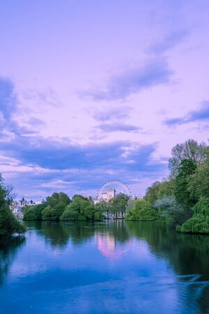 big wheel: The lake in St James park London with the big wheel in the background Stock Photo