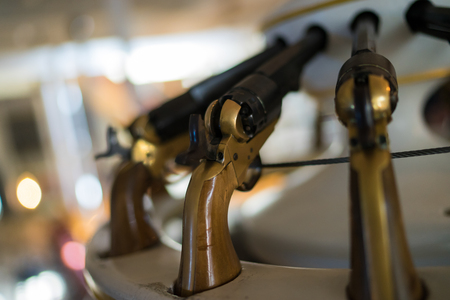 handguns: Old handguns onboard a naval ship at Portsmouth. Stock Photo