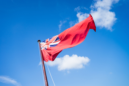 ensign: The navy ensign flying from a ship at Portsmouth.