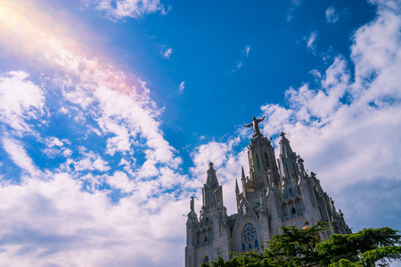 sagrat cor: The church at Tibidabo with lens flare. Stock Photo