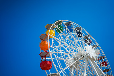 A ferris wheel on top of a hill in Barcelona. Stock Photo