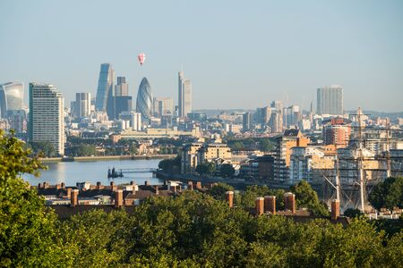 sunny season: Looking over London from Greenwich with a balloon passing