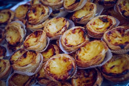 portugese: A big rack of Portugese custard tarts at a market. Stock Photo