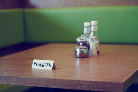 south london: A reserved table at a cafe in south London. Stock Photo