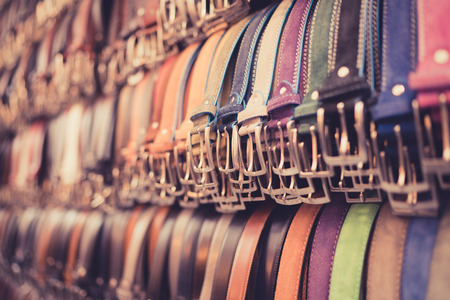 A number of belts in a Florence market.