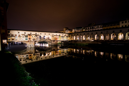 river arno: The river Arno in Florence at night. Stock Photo
