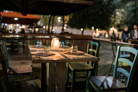 A candle lit table at a bar in Florence. Reklamní fotografie