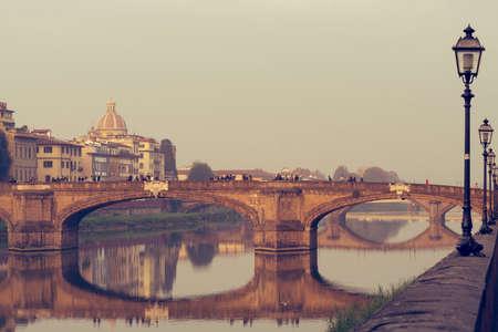 Looking around the river Arno at Trinita bridge.