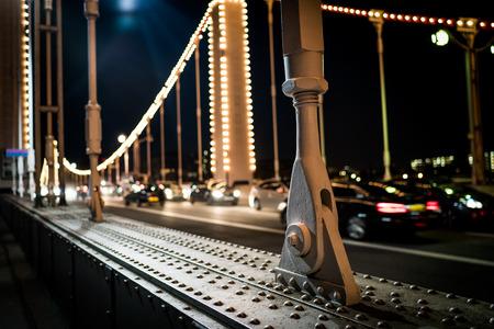 chelsea: A pillar on Chelsea bridge at night.