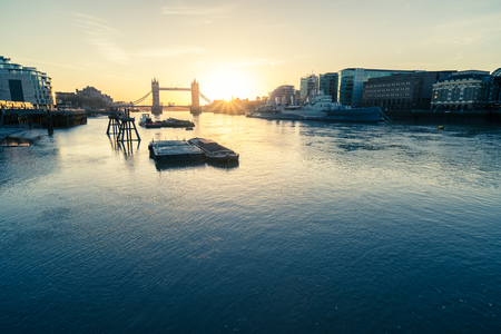 winter sunrise: A wide shot looking past tower bridge in London.