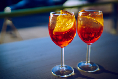 A pair of cocktails in glasses in summer.