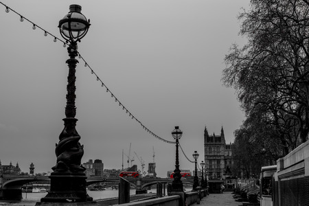 A shot taken at Westminster with two red buses.