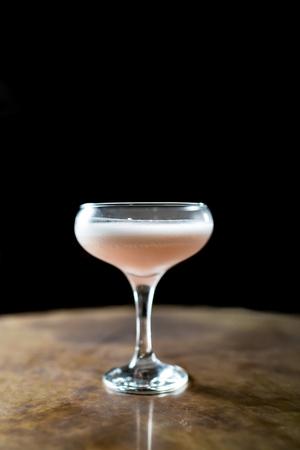 A shot of a single pink cocktail. Reklamní fotografie