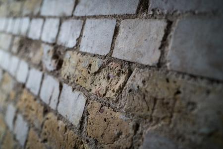 A shot of a weathered brick wall. Reklamní fotografie