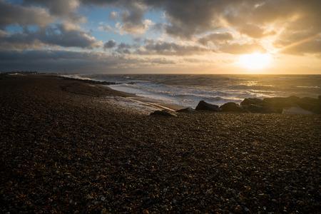 Looking over the Brighton pebbles at sunrise. Reklamní fotografie