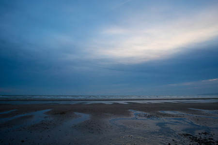A photo of a sunset in Camber sands.