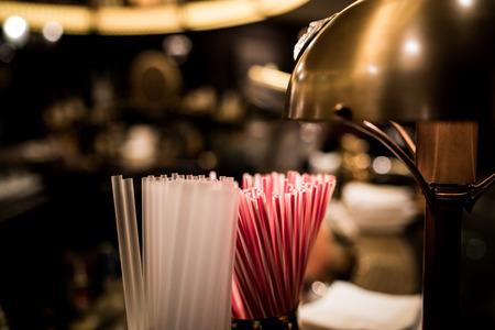 hotel bar: A bunch of straws at a hotel bar. Stock Photo