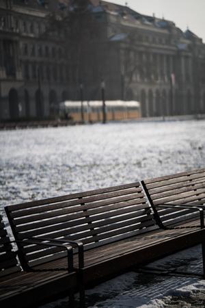 A bench in Budapest near Parliament in winter. Reklamní fotografie