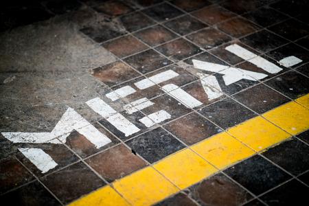 Metal written on the floor of a workshop. Reklamní fotografie