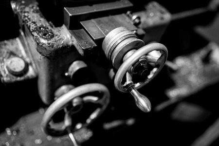 A blurred shot of machinery parts in mono.