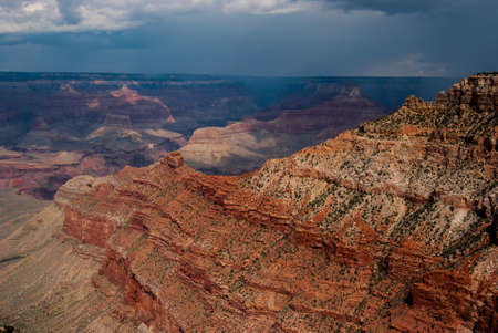 enveloping: Photograph of a storm enveloping the North rim of the Grand Canyon.