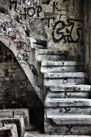 devastation: Abandoned building with ran down staircase Stock Photo