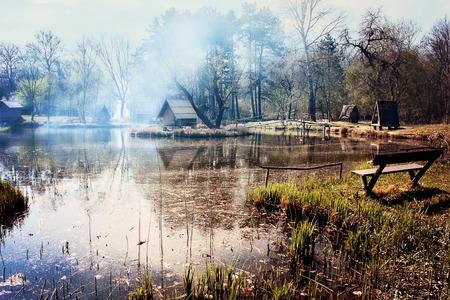 fishing cabin: Fishing lake covered in smoke Stock Photo
