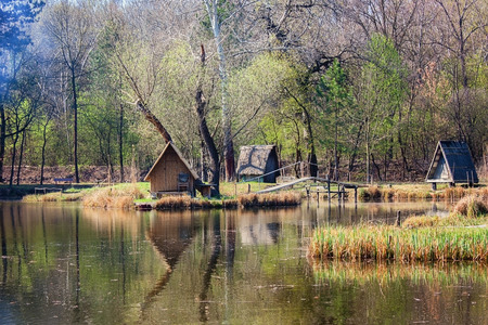 Beautiful fishing pond with cabins  photo