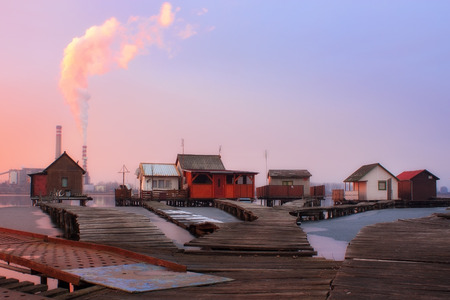 fumes: Beautiful sunset over lake with factory fumes