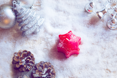 Red Advent Candle and Christmas decorations on snow Stock Photo