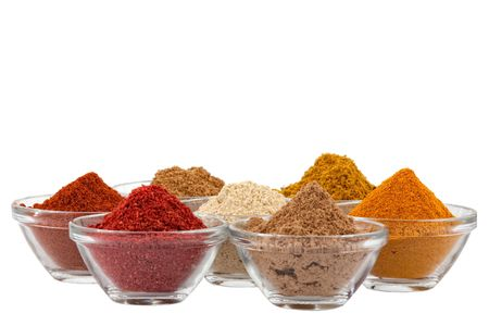 several indian spices in glass bowls photo