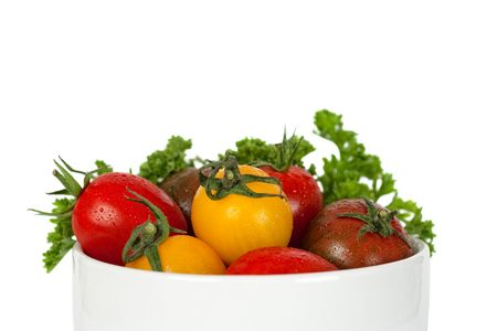 small tomatoes in bowl, isolated on white background photo