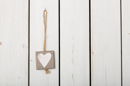 cordially: Heart decoration on wood