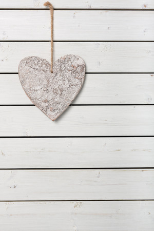 cordially: Heart with ribbon on wood