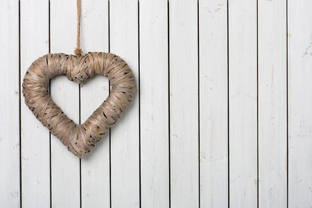 cordially: Big heart on light wood