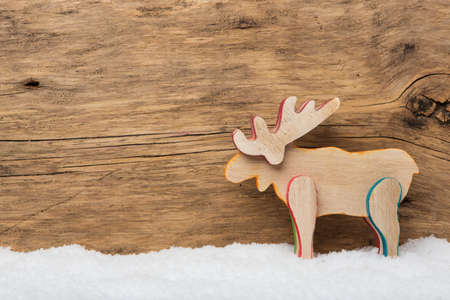 santa moose: Elk on wooden background with snow Stock Photo
