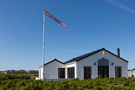 Traditional Danish House with Danish flag photo