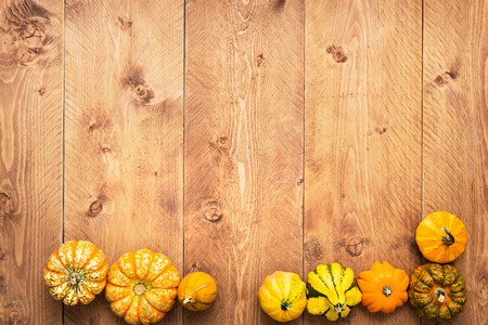 Colorful Pumpkins on wooden background - Halloween, Thanksgiving Stock Photo