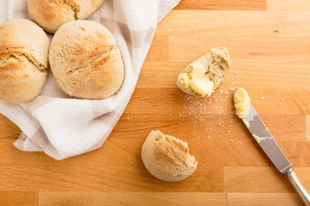 crust crusty: Freshly baked buns with butter and salt