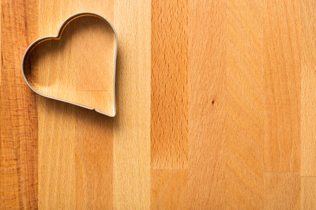 cutter: Cookie cutter on wooden table