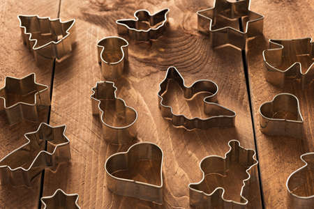 cutters: Cookie cutters on wooden table
