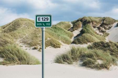 SOS sign at the beach Stock Photo