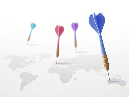 4 darts on a world map symbol of travel