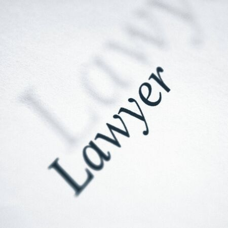 jurist: (word series)lawyer written on a white paper