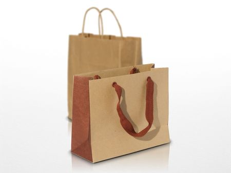 recycled kraft paper - ecological shopping bag on a white grey background