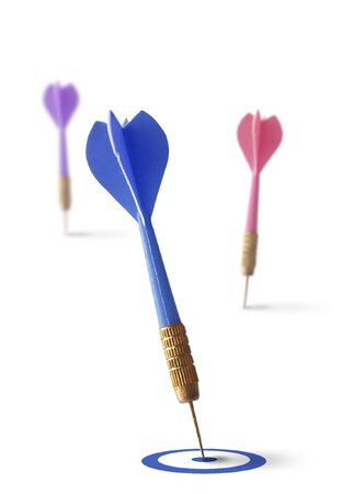 professionalism: three darts isolated on a white background, symbol of business success