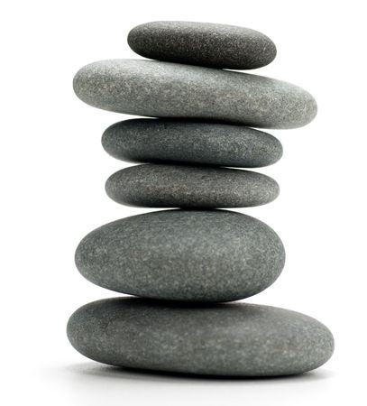 6 pebbles stacked and isolated on a white background