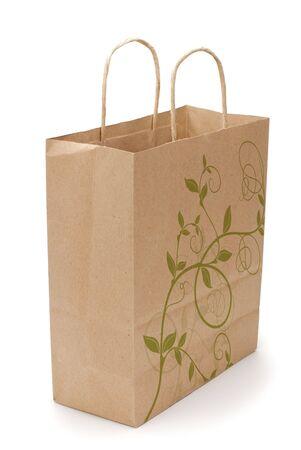kraft shopping bag with reflection isolated on white background photo